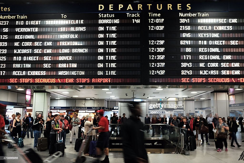 Passengers wait near the depature board as normal service returned between New York City and Philadelphia on May 18 2015 in New York City Service in...
