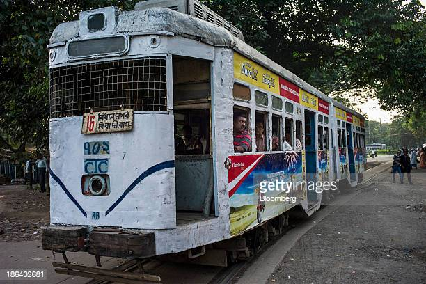 Passengers wait on a Calcutta Tramways Company Ltd tram as it sits parked at a depot in Kolkata West Bengal India on Wednesday Oct 30 2013 Asia's...