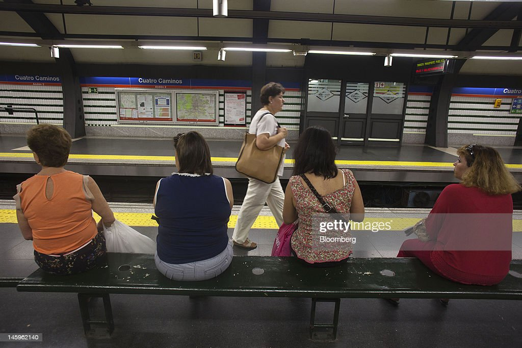 Passengers wait on a platform at the Cuatro Caminos metro station in Madrid, Spain, on Friday, June 8, 2012. Spain is poised to become the fourth of the 17 euro-area countries to require emergency assistance as the currency bloc's finance chiefs plan weekend talks on a potential aid request to shore up the nation's lenders. Photographer: Angel Navarrete/Bloomberg via Getty Images