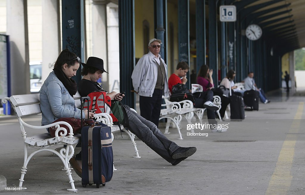 Passengers wait on a train platform at the main railway station in Ljubljana, Slovenia, on Friday, May 10, 2013. The Adriatic nation is seeking to fix its ailing lenders with a cash injection of at least 900 million euros ($1.17 billion) after Cyprus's bailout focused investors on countries with weak banking industries. Photographer: Chris Ratcliffe/Bloomberg via Getty Images