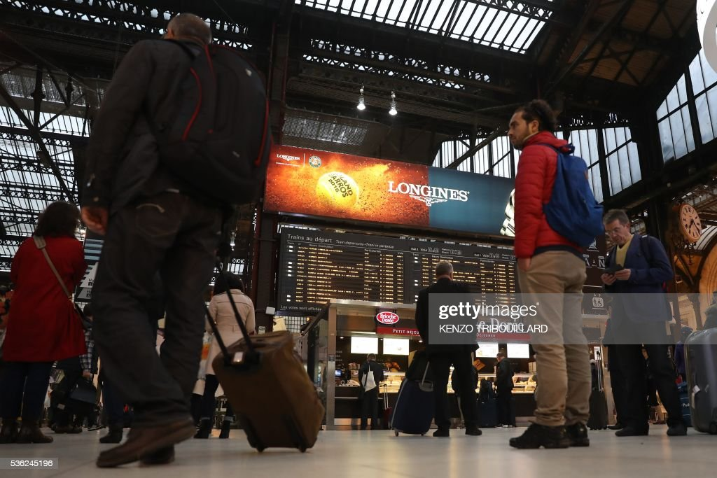 Passengers wait on June 1, 2016 at the Gare de Lyon railway station in Paris, at the start of a strike by employees of French state-owned rail operator SNCF to protest against government labour reforms. Rail strikes in France are expected to take full effect, disrupting transport across the country just over a week before the Euro 2016 football championship starts. / AFP / KENZO