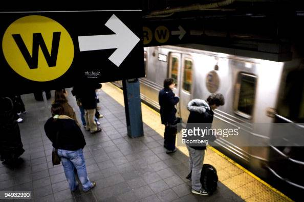Passengers wait on the 'N R W' line platform at the 42nd Street subway station in New York US on Thursday Nov 20 2008 The Metropolitan Transportation...