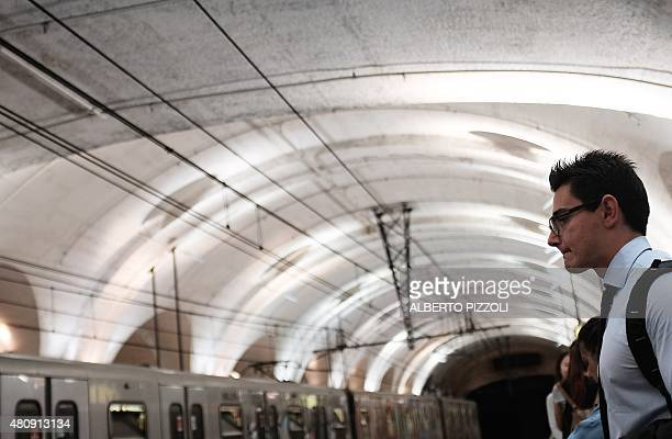Passengers wait on the platform of a Rome subway station on July 15 2015 For the past several days the Rome subway timetable has been hit with delays...