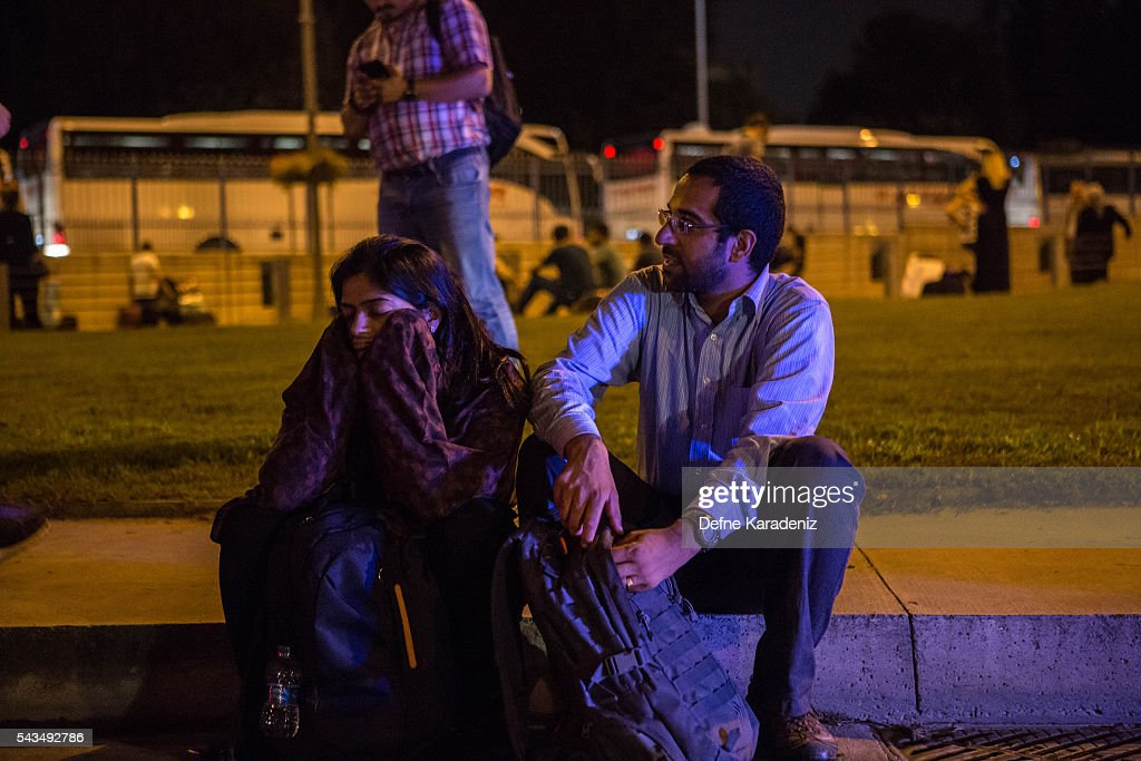 Passengers wait outside Istanbul Ataturk, Turkey's largest airport, after a suicide bomb attack in the early hours of June 29, 2016, Istanbul, Turkey. Three suicide bombers opened fire before blowing themselves up at the entrance to the main international airport in Istanbul, killing at least 28 people and wounding at least 60 people according to Istanbul governor Vasip Sahin.