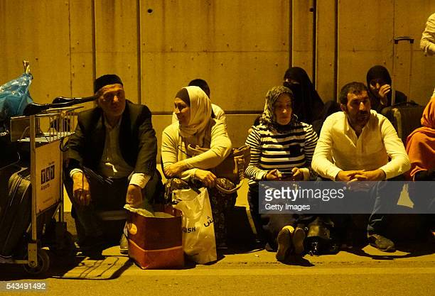 Passengers wait outside Turkey's largest airport Istanbul Ataturk after the suicide bomb attacks June 28 2016 in Istanbul Turkey Three suicide...