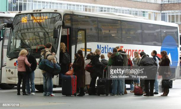Passengers wait to board a National Express coach heading for Stanstead Airport in Victoria coach station London