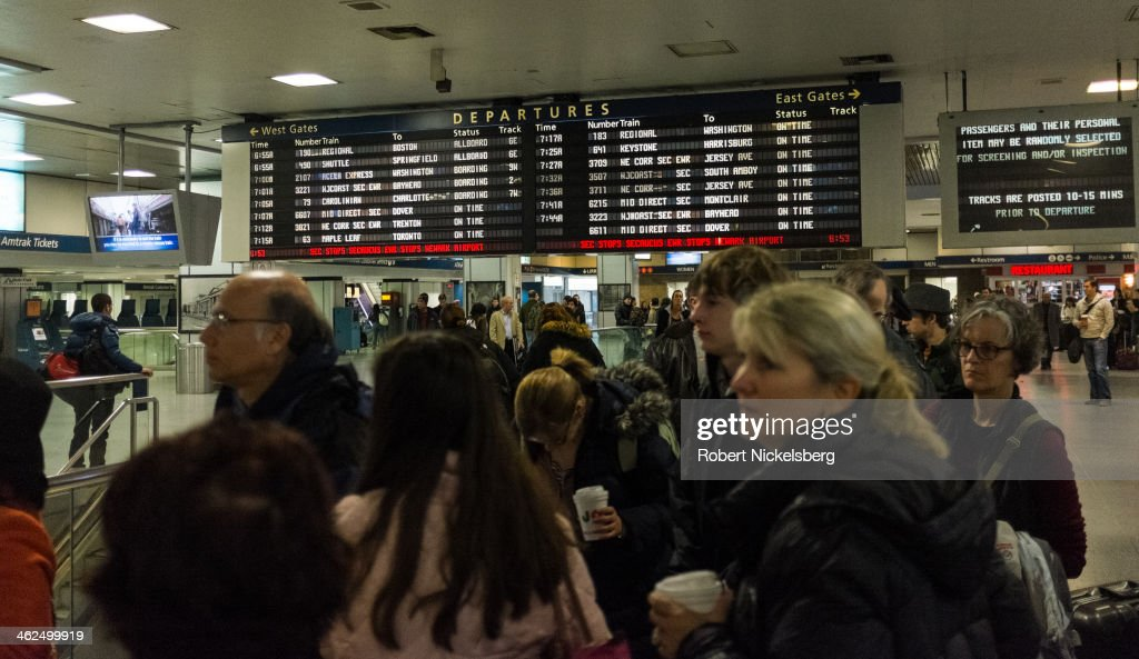 Passengers wait to board an Amtrak train December 2, 2013 at Pennsylvania Station in the Manhattan borough of New York.