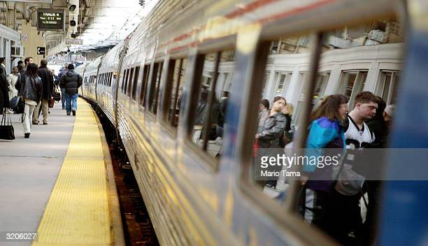 Passengers wait to board an Amtrak train in Penn Station April 2 2004 in Newark New Jersey Security officials have received recent threats regarding...