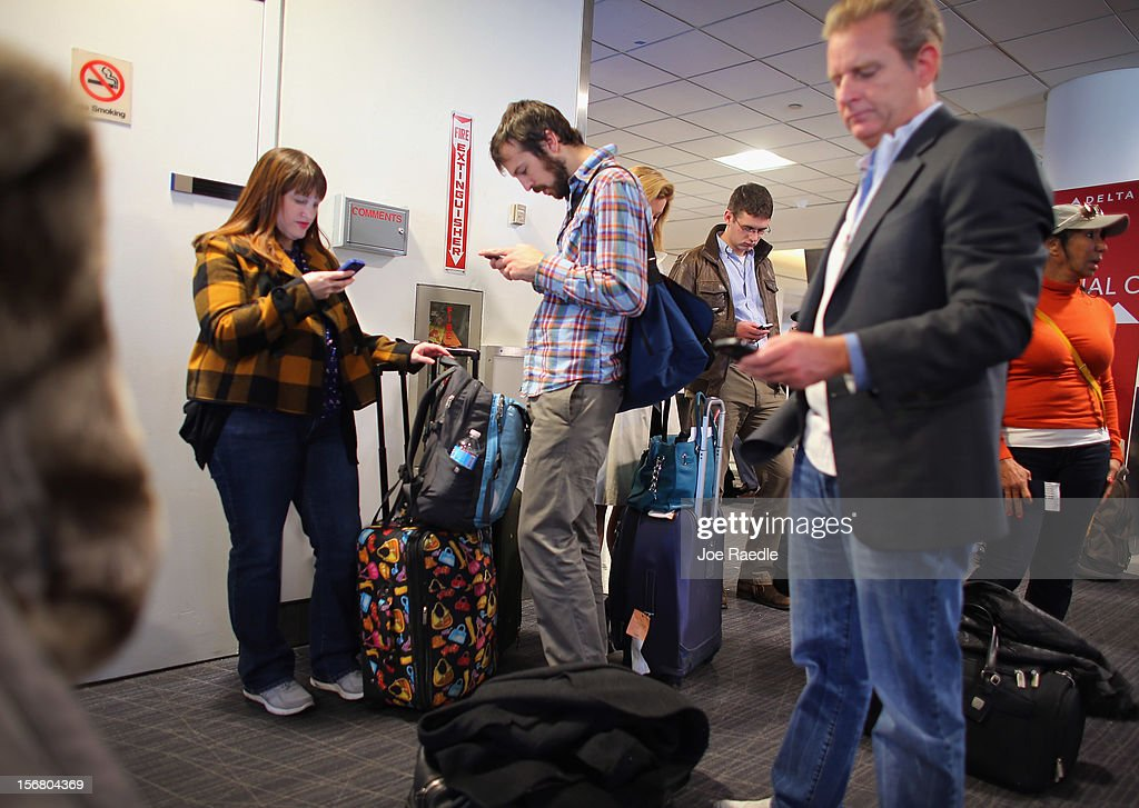Passengers wait to board their plane at the Delta terminal in LaGuardia Airport as they travel on the day before Thanksgiving on November 21, 2012 in New York, United States. The day before the Thanksgiving holiday is one of the busiest travel days of the year.