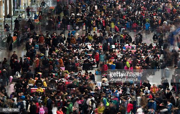 Passengers wait to board their trains as they head to their hometown for the Lunar New Year holiday at Shanghai Hongqiao railway station in Shanghai...