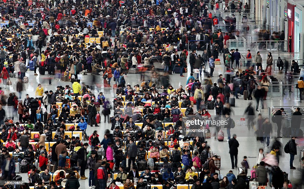 Passengers wait to board trains at Hongqiao Railway Station in Shanghai, China, on Sunday, Feb. 3, 2013. Forecasts of snow and rain across China threaten to disrupt the travel plans of millions of Chinese heading home for the Lunar New Year holidays that start Feb. 9, the national weather agency warned. Photographer: Tomohiro Ohsumi/Bloomberg via Getty Images