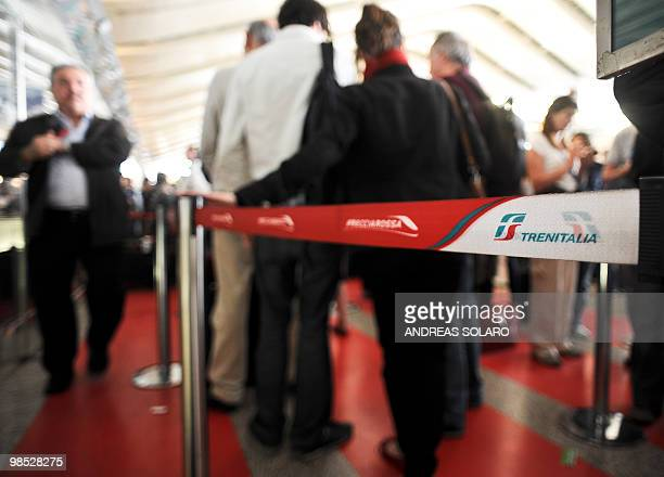 Passengers wait to buy tickets at Termini central train station in Rome on April 18 2010 Airspace across northern Italy will remain closed until 0600...