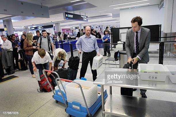 Passengers wait to clear security next to the newly opened TSA PreCheck lane which the Transportation Security Administration launched to cut down...