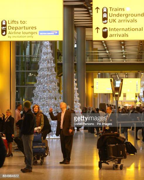 Passengers wait to depart in Terminal 5 at Heathrow Airport before Christmas