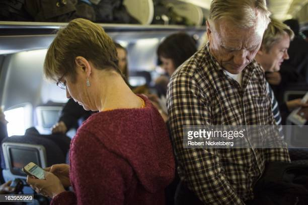 Passengers wait to exit an United Airlines plane from Oslo Norway at the Newark Liberty International Airport March 9 2013 in Newark New Jersey