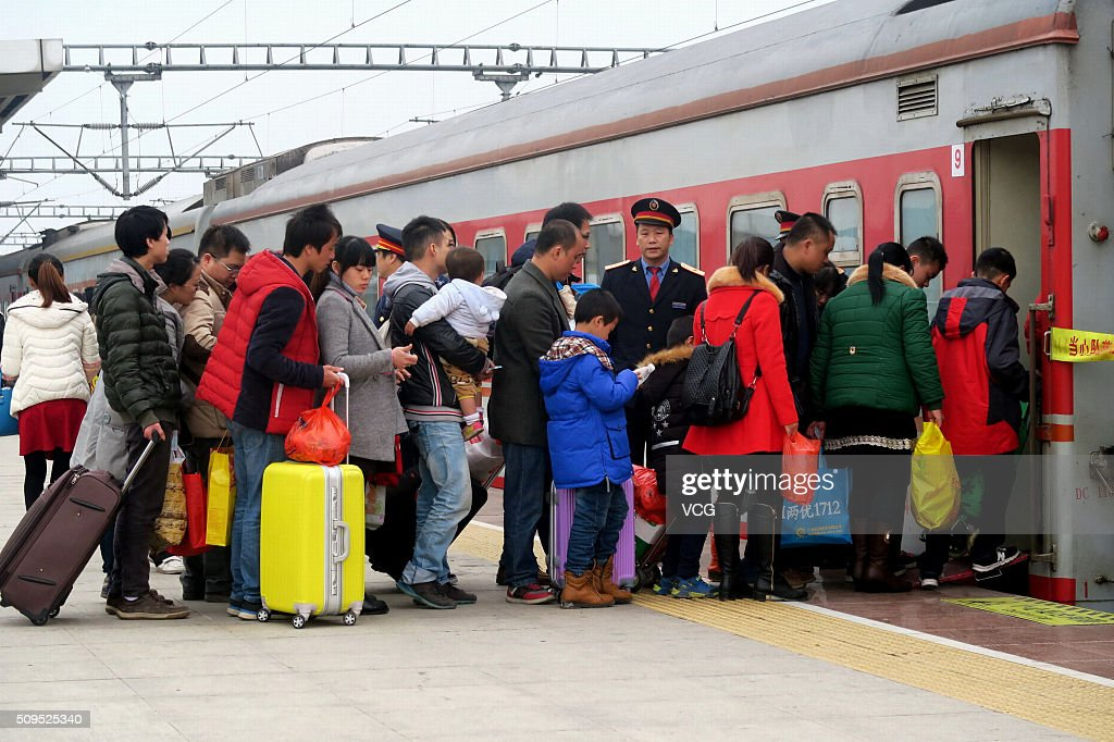 Passengers wait to get on the train at the end of the Spring Festival holiday on February 11, 2016 in Guilin, Guangxi Zhuang Autonomous Region of China. The travel peak appeared from the 5th day of the 7-day holiday for Spring Festival as Chinese people began to return for work or visit relatives.