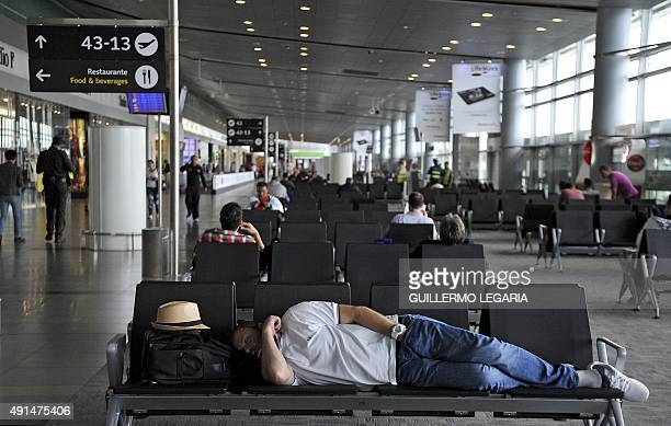 Passengers wait to take a flight at El Dorado international airport in Bogota Colombia on September 25 2015 Trafficking drugs through Bogota's...