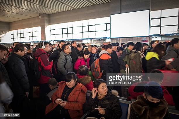 Passengers wait to take their trains back to their hometowns for the 'Spring Festival' or Lunar New Year at Beijing West Railway Station in Beijing...