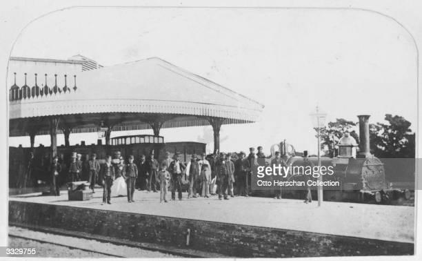 Passengers waiting for a train on a railway platform