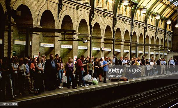 Passengers waiting for subway,  London,  England