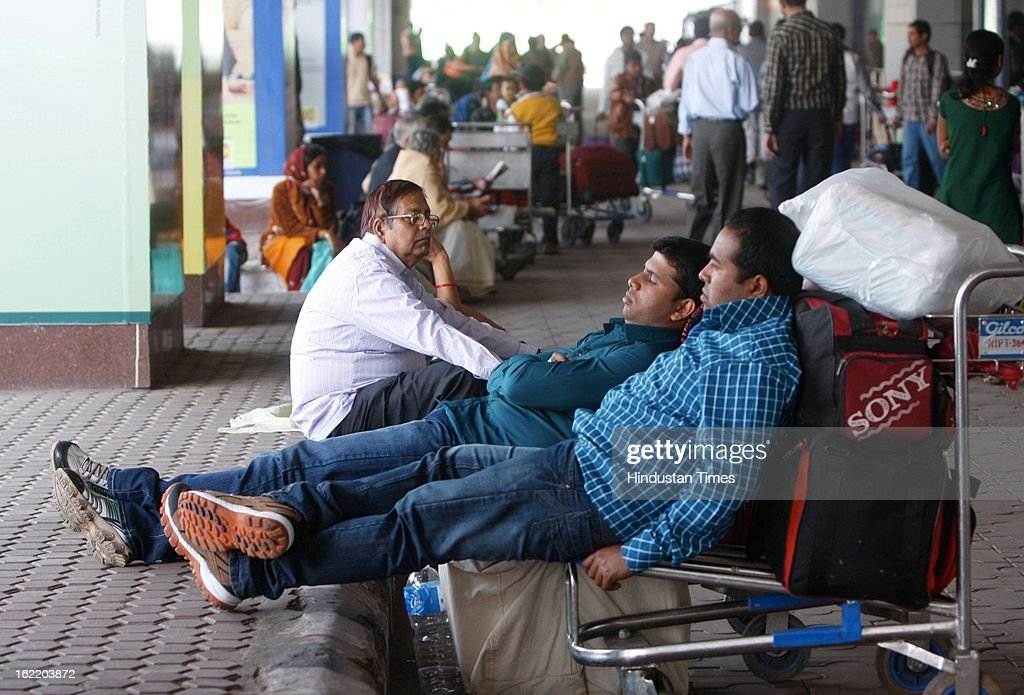 Passengers waiting for taxi at Dum Dum Airport during strike on February 20, 2013 in Kolkata, India. Eleven major Trade Unions called two days nation wide strike (bandh) today and tomorrow to protest against UPA Government's economic and labour policies.