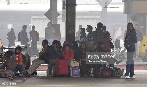 Passengers waiting for their train Trains were delayed due to heavy dense fog at New Delhi Railway station in New Delhi India on Thursday December 1...