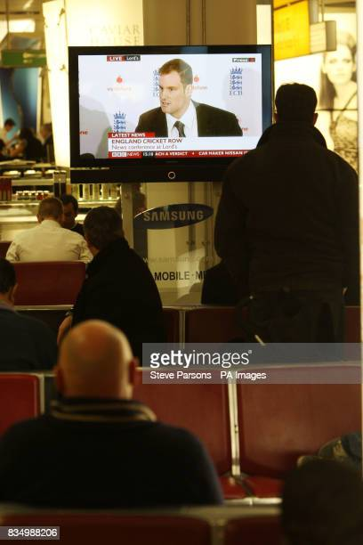 Passengers waiting in departures at Terminal 3 at Heathrow Airport watch the BBC News coverage of Andrew Strauss being named as England cricket team...