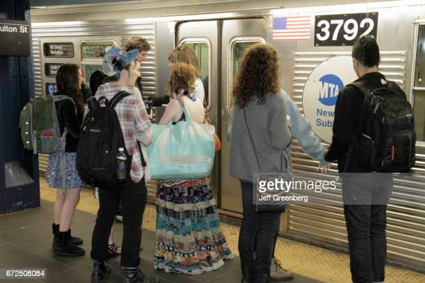Passengers waiting on the platform at Fulton Street Station