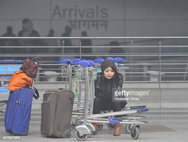 Passengers waiting outside on arrival side as dense winter fog caused delay in many fight at T3 Terminal Airport at the Indira Gandhi Airport on...