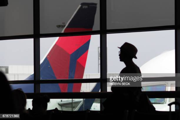 A passengers waits for a Delta Airlines flight in Terminal 5 at Los Angeles International Airport May 4 2017 in Los Angeles California In yet another...