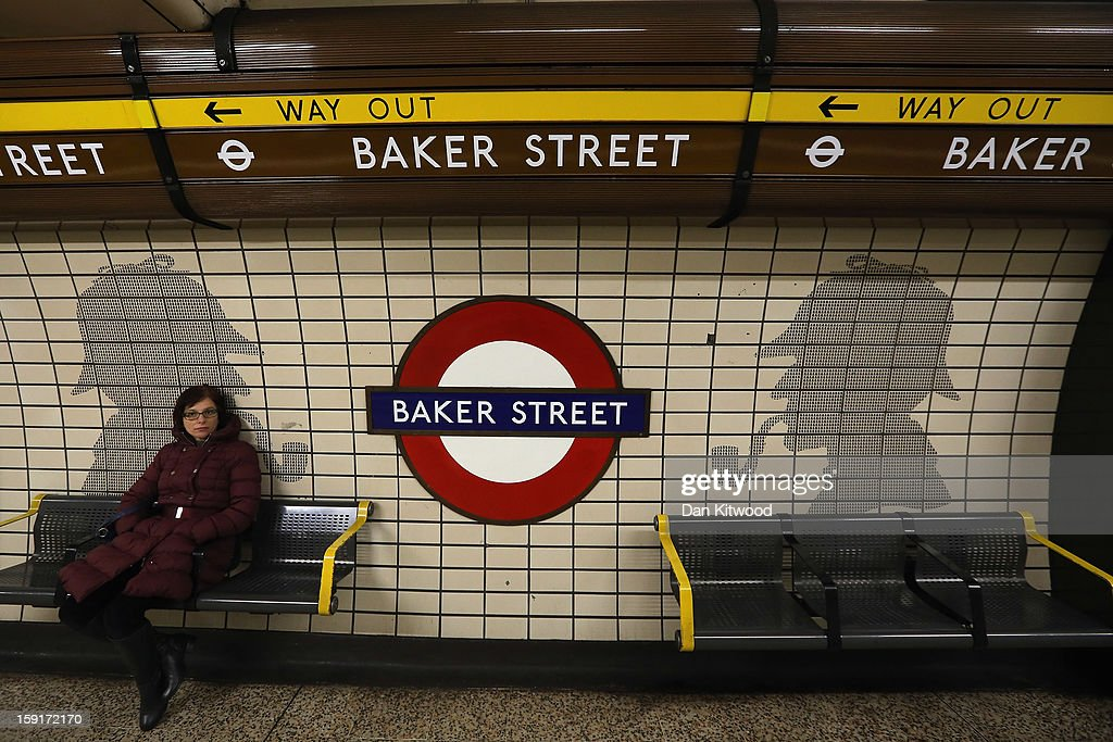 A passengers waits for a train at Baker Street Underground Station on January 9, 2013 in London, England. Baker Street Station shares the 150th Anniversary of its opening on January 10th, 2013 with the London Underground. Commonly called the Tube, the London Underground is the oldest of its kind in the world and now carries approximately a quarter of a million people around its network of 249 miles of track every day. Baker Street station was remodeled between 1911-13 by architect Charles W Clark to its present form as part of a comprehensive rebuilding project by the Metropolitan Railways with the station as its new company headquarters and flagship station, where it quickly became known as the 'Gateway to Metro - Land'. Outside the Marylebone Road exit, a large statue commemorates Sherlock Holmes, Sir Arthur Conan Doyles ficticious detective who resided in the novels at 221B Baker Street.