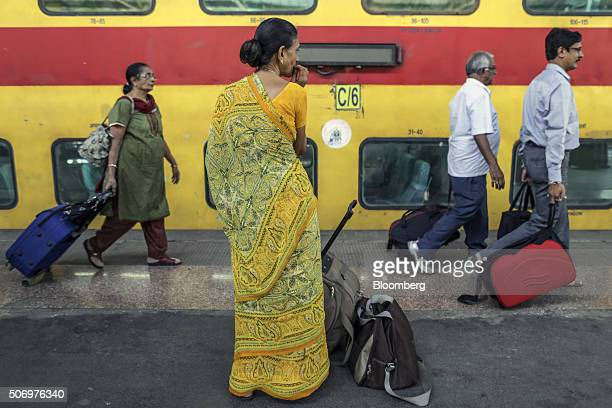 Passengers walk along a platform with their luggage at Mumbai Central Train Station in Mumbai India on Friday Jan 22 2016 Global investors are...