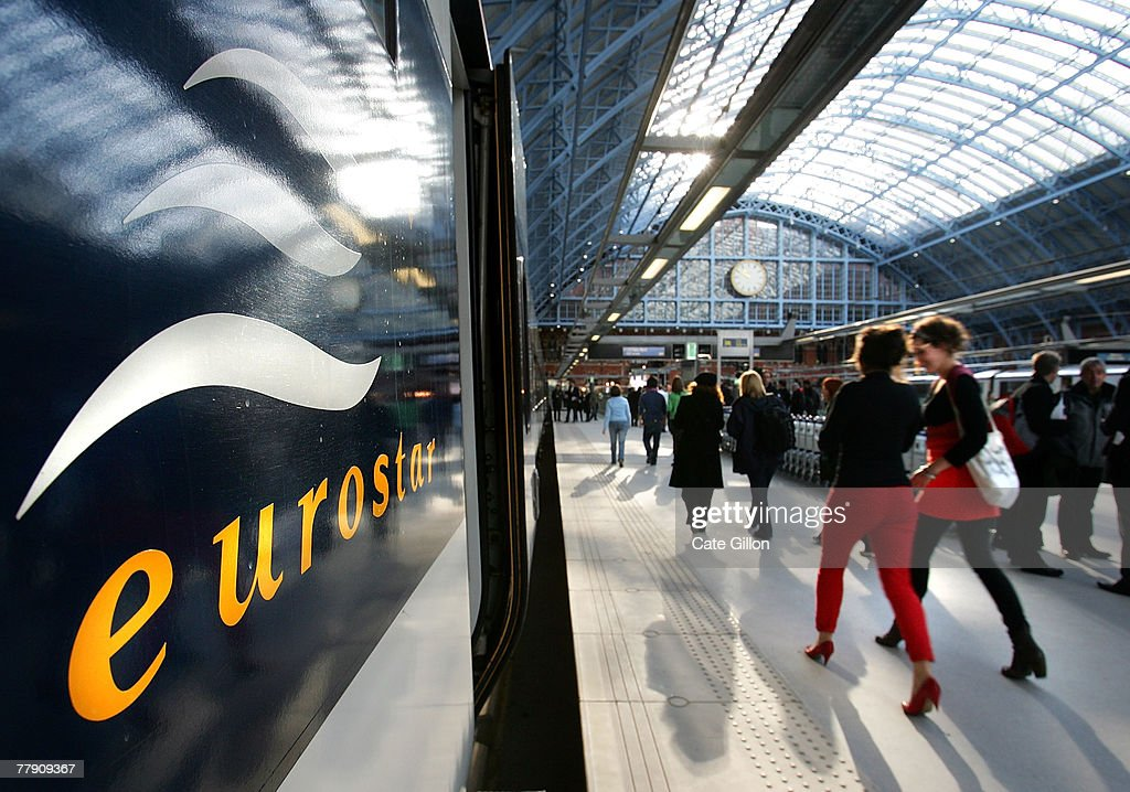Passengers walk alongside the first train to leave from the Eurostar platform at St Pancras International station on November 14 2007 in London...
