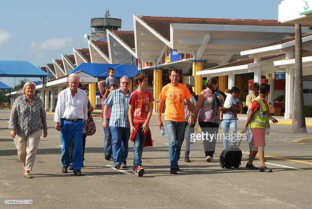 Passengers walk at Moi International Airport in Mombasa as their Air France flight from Mauritius to Paris is grounded after a suspected bomb was...