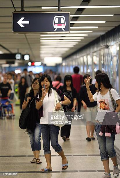 Passengers walk down a corridor at a Mass Transit Railways station in Hong Kong 09 October 2007 Shares of Hong Kong's largest railway operator MTR...