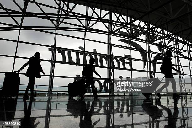 Passengers walk in a terminal at the airport as pilots of Lufthansa go on a 15 hours on a strike in Frankfurt Germany on September 30 2014 A union...