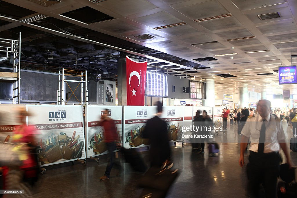 Passengers walk in the damaged parts of the international terminal of the country's largest airport, Istanbul Ataturk, following yesterday's blast on June 29, 2016 in Istanbul, Turkey. Three suicide bombers opened fire before blowing themselves up at the entrance to the main international airport in Istanbul yesterday. The Istanbul Governor's Office says 41 people have been killed, 37 of the victims have been identified, including 10 foreign nationals and three people with dual citizenship. More than 230 people were wounded but 109 have been discharged from hospitals in the deadly suicide bombing attack in Istanbul's Ataturk airport blamed on the Islamic State group.