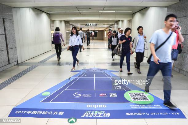Passengers walk in the Lincuiqiao Station which has been decorated for the upcoming China Open on the Beijing Subway Line 8 on September 25 2017 in...