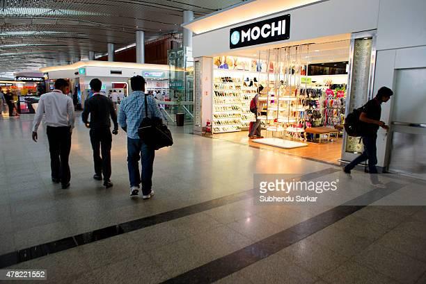 Passengers walk in the lounge at Rajiv Gandhi International Airport in Hyderabad