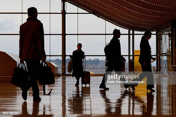 Passengers walk inside Madrid Barajas Adolfo Suarez airport which is operated by group Aena on February 11 2015 in Madrid Spain Shares in...