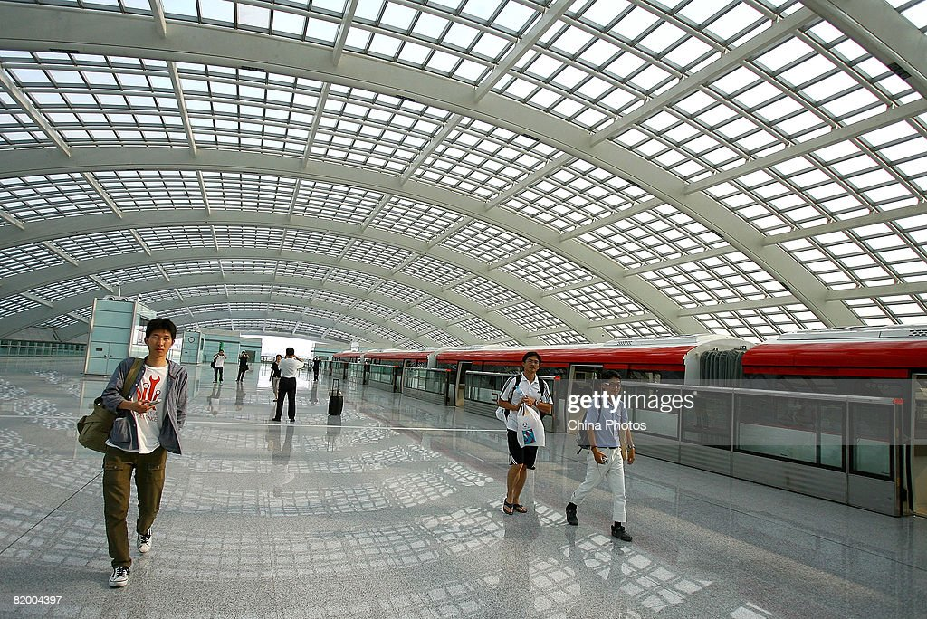 Passengers walk on the platform of the Airport Line at the Terminal 3 building of Beijing Capital International Airport on July 19, 2008 in Beijing, China. Beijing opened Line 10, the Olympic Branch Line and the Airport Line today for the upcoming Olympic Games.
