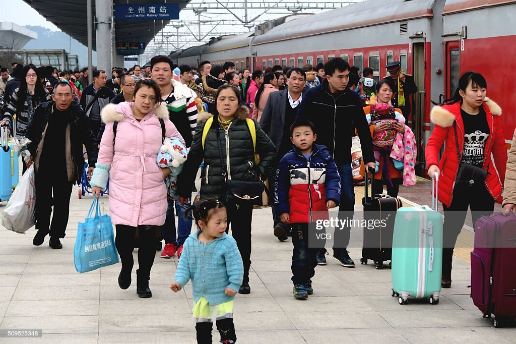 Passengers walk on the railway platform at the end of the Spring Festival holiday on February 11, 2016 in Guilin, Guangxi Zhuang Autonomous Region of China. The travel peak appeared from the 5th day of the 7-day holiday for Spring Festival as Chinese people began to return for work or visit relatives.