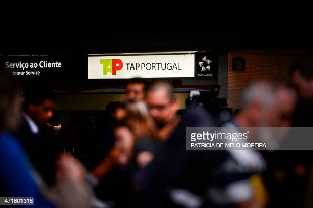 Passengers walk past a TAP airline's costumer service desk at Lisbon's Airport during a pilots strike on May 1 2015 Portuguese stateowned airline TAP...