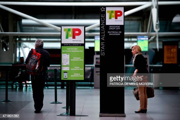 Passengers walk past a TAP airline's info billboard at Lisbon's Airport during a pilots strike on May 1 2015 Portuguese stateowned airline TAP pilots...