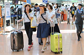Passengers walk through the departure lobby of Haneda Airport in Tokyo Japan on Wednesday Aug 12 2015 Treasuries' liquidity was less than usual in...