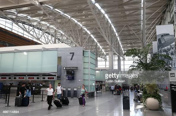 Passengers walk through the international terminal at San Francisco International Airport on March 13 2015 in San Francisco California According to a...