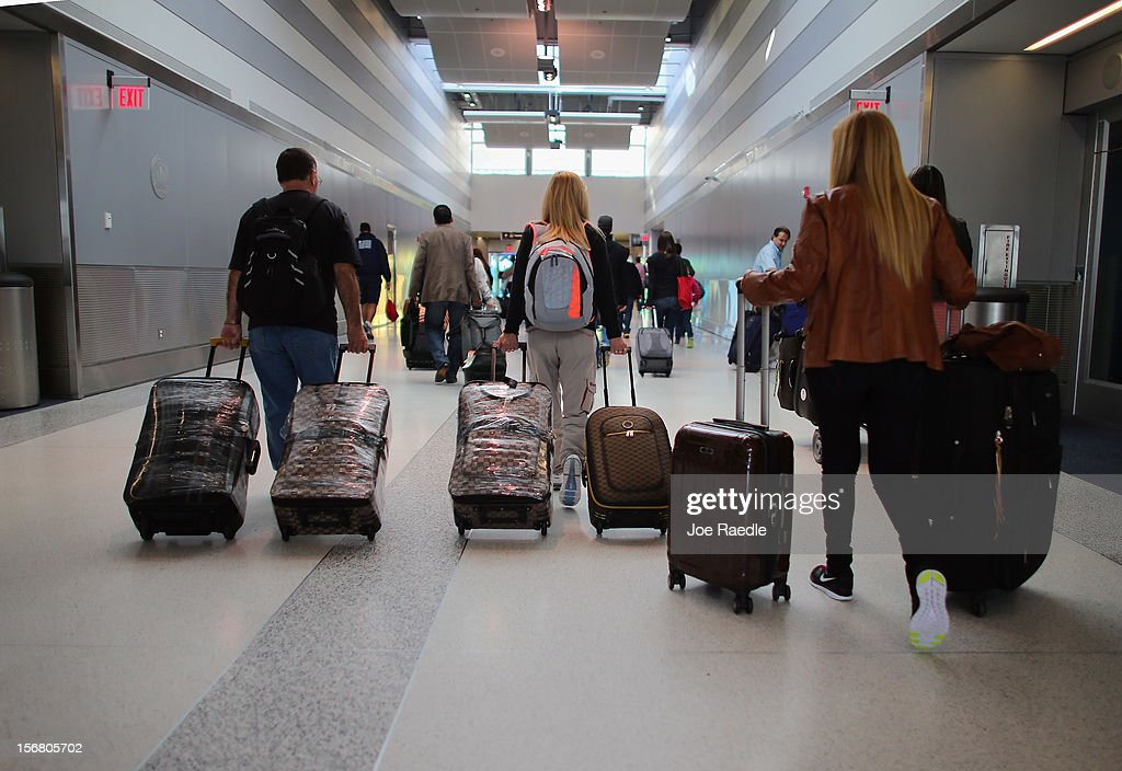 Passengers walk through the Miami International Airport as they travel on the day before Thanksgiving on November 21, 2012 in Miami, Florida. The day before the Thanksgiving holiday is one of the busiest travel days of the year.