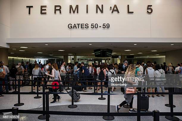 Passengers walk through the newly renovated TSA Security checkpoint area of Terminal 5 at Los Angeles International Airport in Los Angeles California...