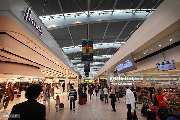 Passengers walk through the shopping area at terminal five at Heathrow airport on August 27 2010 in London England Heathrow's 66000 employees will...