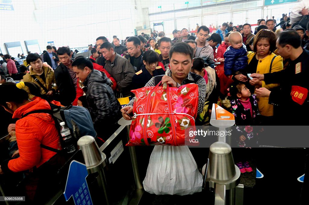 Passengers walk through the wicket in a railway station at the end of the Spring Festival holiday on February 11, 2016 in Guilin, Guangxi Zhuang Autonomous Region of China. The travel peak appeared from the 5th day of the 7-day holiday for Spring Festival as Chinese people began to return for work or visit relatives.